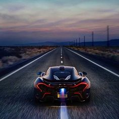 Flame throwing exhaust is just one way of making a statement #opulentmonde #mclaren #p1 #amazing #photooftheday #car #fire