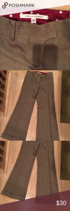 Diane Von Furstenberg Wool Dress Pants Excellent condition. Flares out at the bottom. Size 0. These pants would be a good fit for a short person...5'1-5'2 inches Diane von Furstenberg Pants Boot Cut & Flare