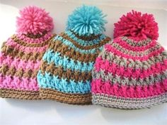 Adorable crocheted hats with pom poms by crochetmagic
