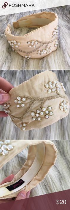 Anthropologie Joshipura Champagne Gold Headband Excellent Used Condition. Champagne satin with metallic gold embroidered vines and flower clusters made of gold sequins topped with pearl beads. Some light discoloration of the inner side (see pics 1 and 3), but completely hidden when wearing. Anthropologie Accessories Hair Accessories