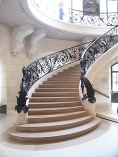Magnificent iron scroll staircase