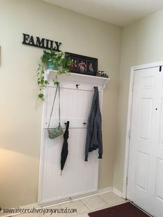 Wish your front entryway was more organized for you and guests? I'm a professional organizer and here's how we made a functional & stylish DIY entryway wall organizer for our own home. Wall Organization, Entryway Wall Organizer, Entryway Storage, Organization Ideas, Metal Storage Cabinets, Wall File, Diy Concrete Planters, Drop Cloth Curtains, Framed Fabric