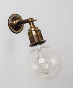 'Ned' industrial style wall light from Olive and the Fox - available in old brass, bronze or nickel. Want!