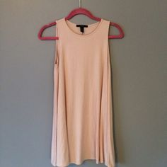 Peach colored dress This has never been worn. Basically new but I threw out the tags. Bought from Forever 21, size small. Forever 21 Dresses Mini