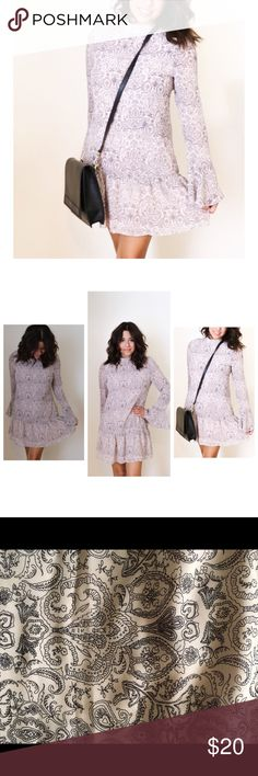 Dress Taupe colored with black floral designs. Has wide bell sleeves. The back has button closure. Dresses