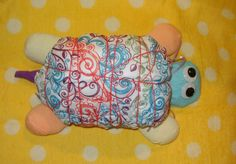 Unique Turtle bumGenius Cloth Diaper Cake for by CushyCreations - really cute but maybe use fishing line or clear rubberbands?  Love the Lovelace diaper...my favorite!