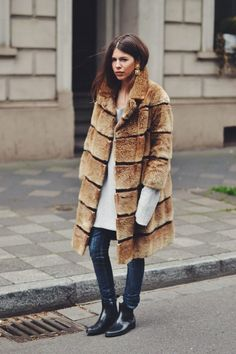Oversized fur coat with long sweater.