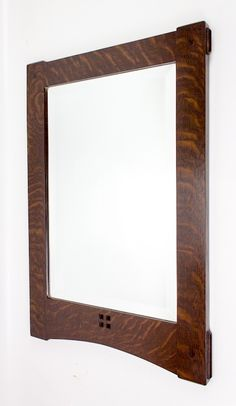 Arts and Crafts through mortise and tenon mirror frame in quarter sawn white oak.