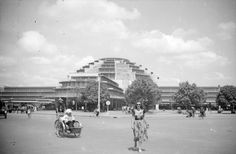 The Central Market, Phnom Penh; The Grand Market; Psar Thmei The market dates from the colonial period, 1935-1937, and its surrounding streets were built around 1946. Ernest Hebrard, head of the French Town Planning Service in Indochina, was responsible for the town planning. The main entrance to the market faces east towards Street 136, and the market is bounded by Streets 67, 130, 53 and 126. It has a central domed hall with four arms, and market stalls fill the surrounding areas.