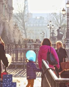 The girl with the blue balloon.  Paris December 2016.  #Paris #StreetPhotography #TravelPhotography #Flaneurbanite
