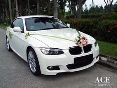 pink wedding car | Materials: White & Pink Artificial Flowers, Green Satin Ribons