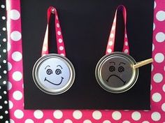 whole brain teaching smiley/frowney face chart.  paint can lids with clothes pins.