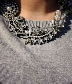 Crystal and pearl necklace against a simple grey knit. Details In Streetstyle