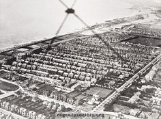Aerial view of Aldrington – Autumn 1929. Because of the number of roads in which houses are being built, it is possible to date this photograph within a few months. Beyond Marine Park, Saxon and Roman Roads had yet to be built and further west there are gaps where Glastonbury Road and St Keyna Avenue are now. In the foreground are unmade roads, Princes Crescent and Princes Square. The old Hove – Aldrington boundary was just this side of the Tennis Courts.