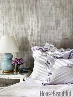 A Studio E metallic wallcovering, Inge, gives the master bedroom walls a silvery luminosity.