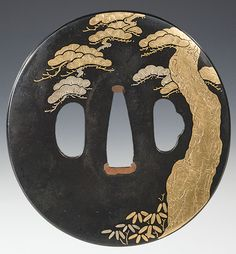 A Japanese Gold and silver-inlaid tsuba, circa 19th century.