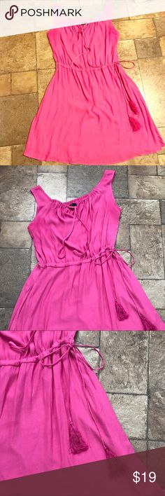 GAP Pink Silk-like Sun Dress Medium M Gorgeous pink/fucsia sun dress from GAP. 100% polyester feels super silky. Tassel tie waist. Has pockets!!  Worn 1-2 times max. Gently used and ready for new closet. Size medium. From pet and smoke free home. GAP Dresses