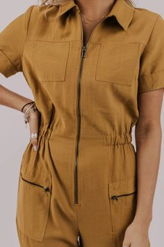 Turn heads in this unique jumpsuit. Tucson Jumpsuit features regular fold over collar paired with long zipper down the front. Elastic waistband and front patch pockets. Ruffle Jumpsuit, Jumpsuit Outfit, Casual Jumpsuit, Printed Jumpsuit, Romper Pants, Brown Jumpsuits, Jumpsuits For Women, Modest Outfits, Modest Clothing