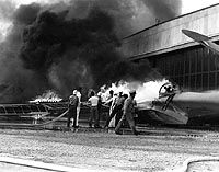 PEARL HARBOR ATTACK (12/2/1941) -- PBY patrol bomber burning at Naval Air Station Kaneohe, Oahu, during the Japanese Attack on Pearl Harbor ~ Official U.S. Navy Photo / National Archives collection _____________________________ Reposted by Dr. Veronica Lee, DNP (Depew/Buffalo, NY, US)