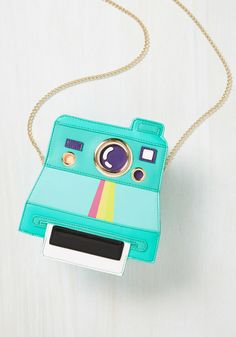 A polaroid purse that'll encourage you to do it for the 'gram. | 21 New Products Under $50 That'll Put A Smile On Your Face