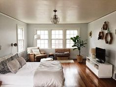 bedroom decorating ideas for couples bedroom with hardwood floors Ski Slope by Sherman Williams