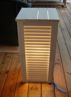 take some old shutters, screw them together and put an old lamp inside for instant upcycled lamp
