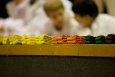Different coloured #Karate #Belts with Karate Kids in the background