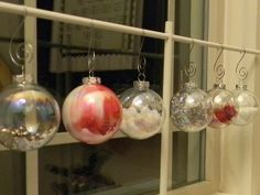 DIY Christmas Ornaments - Fill clear glass ornaments with paint, pom poms, glitter (be sure to use spray adhesive), etc!