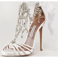 Go glitz and glam with these fabulous @tabithasimmons heels for your walk down the aisle.