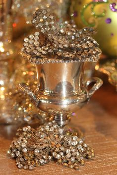 I use Old Rhinestone Pins as decor. They look great sitting on little silver toothpick urns.