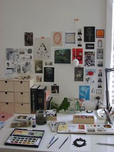 Inspiring wall. Large window and surrounded by art supplies. What better way to keep a creative space?!