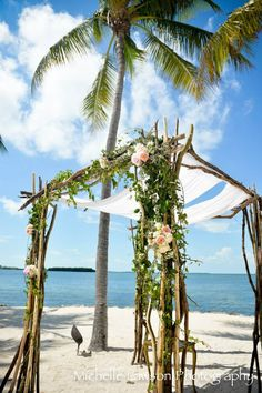 Simple Flower Arrangement Arch By The Waterview For Wedding Ceremony At Key Largo Lighthouse Beach