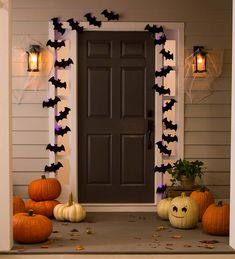 A bat colony at your front door? Hang our Light-Up Bat Colony String Lights and greet friends and neighbors with a batty smile! Cluster the two 10'L strands together to resemble a bat colony, or arrange in any way you like. (Sure, we know bats don't really exude a purple glow…but that just adds to the spooky fun factor!) These lights can be used inside or in a covered area outdoors. A simple way to add some fun décor to your Halloween decorations! 2 AA batteri Victorian Halloween Decorations, Halloween Decorations Inside, Outdoor Halloween Lights, Purple Halloween, Up Halloween, Halloween Crafts For Kids, Halloween Front Doors, String Lights, Strands