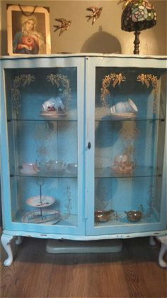 Shabby Chic distressed display cabinet. Duck egg blue, with delicate lace back