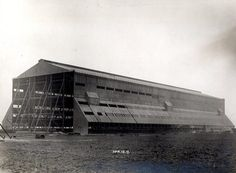 Cardington airship shed with shuttering to main structure completed 18 April 1917.  One of a set of photographs to accompany a paper by T. M. Rounthwaite; 'The Royal Naval Air Works, Cardington, Bedford, with some notes on their construction'  which was read before the ICE Newcastle-upon-Tyne local association 27 February 1922 (ref 0C4453