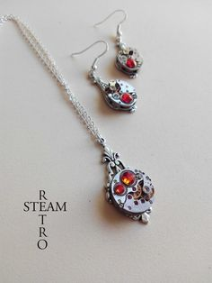 Items similar to Steampunk Jewelry set in Fireopal - Steampunk wedding set - Steampunk Necklace & Earrings - Christmas gift - Gift for her on Etsy Gift Sets, Steampunk, Pendant Necklace, Trending Outfits, Unique Jewelry, Handmade Gifts, Etsy, Vintage, Kid Craft Gifts