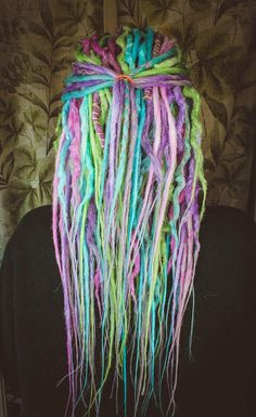 Double Ended Synthetic Dreads Wavy Unicorn Set  This set uses shades: Light Silver White Pink Purple/Violet Blue Green MIX from wavy (30-35 cm) & smooth (50 cm) dreads  10 pieces = 20 end 20 pieces = 40 end 30 pieces = 60 end 40 pieces = 80 end  FULL SET 50 pieces = 100 end  length 35-50 cm folded in the form of two  ______________________________________________________________________   Please note: the creation of dread (processing time ) takes 2-3 weeks. ...