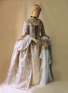 Taffeta gown c.1765-75, England. Gown of 'clouded silk' - silk taffeta with a warp printed pattern between woven stripes. The petticoat is of quilted silk satin.| Hopkins Collection, The School of Historical Dress.