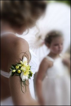 Brides arm flowers - added dimension to the brides accessories