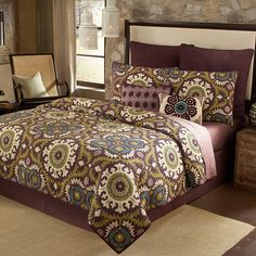 New alternative for bedding from Bed Bath & Beyond. The quilt set we had chosen from JC seems to have poofed from their web site. I tend to like REALLY bold while Mel has said she wanted something more neutral and relaxing for the BR. I would also like to go with a deeper purple with rich green accents for the paint color - Valspar's Purple Davenport 1003-3A. I don't know how to post colors, but Mel does. I think this will go well with the white furniture.