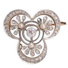 Antique Edwardian Diamond Pearl Millegrain Trefoil Brooch   From a unique collection of vintage brooches at https://www.1stdibs.com/jewelry/brooches/brooches/