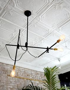 Industrial light fixture on detailed ceiling