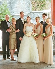 All in the Family- The bride and groom posed with her family for portraits with photographer Liz Banfield. Not to forget this kind of photo op