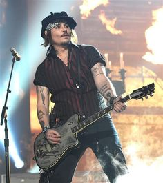 Leave it to Johnny Depp to bring legitimate rock and roll to the Grammys! With his band The Hollywood Vampires, Johnny, along with Alice Cooper and Joe Perry, used pyrotechnics and loud (really loud!) guitars to entertain the crowd, playing one of their original songs.