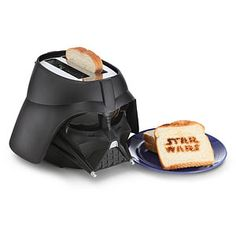 "It's breakfast time. Pop some bread into Vader's head, and you'll have the most Star Wars-y toast ever. Your bread will now have ""Star Wars"" toasted onto one side!"