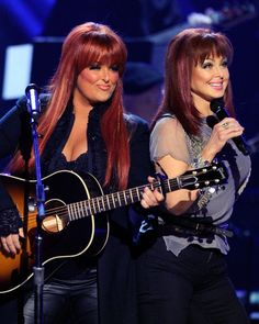 The Judds - how could you not love these fiery, redheaded women? one of the few women who sound like country music and dont end up going the pop direction - one of there favorite songs -'' why not me'' or i saw the lightttt in your window tonight'' when my father use to deejay at a local radio station - i still remember twirling in circles to there music like a princess.