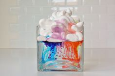 "This shaving cream rain clouds experiment is a fun, easy and beautiful activity to do with kids. Watch as the ""rain"" falls down from the clouds!"