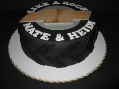 Chevy Truck Inspired Grooms Cake - 10 White cake tire with the chevrolet logo.  The grooms first love was his truck.  TFL!