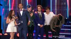 Everyone looks professional and then there is Josh, licking the award...