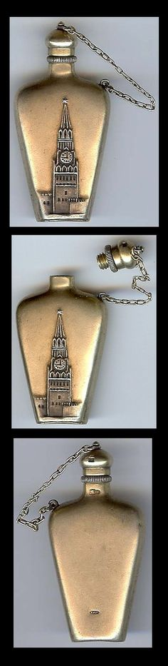 Vintage silver perfume bottle has Big Ben embossed on the front.